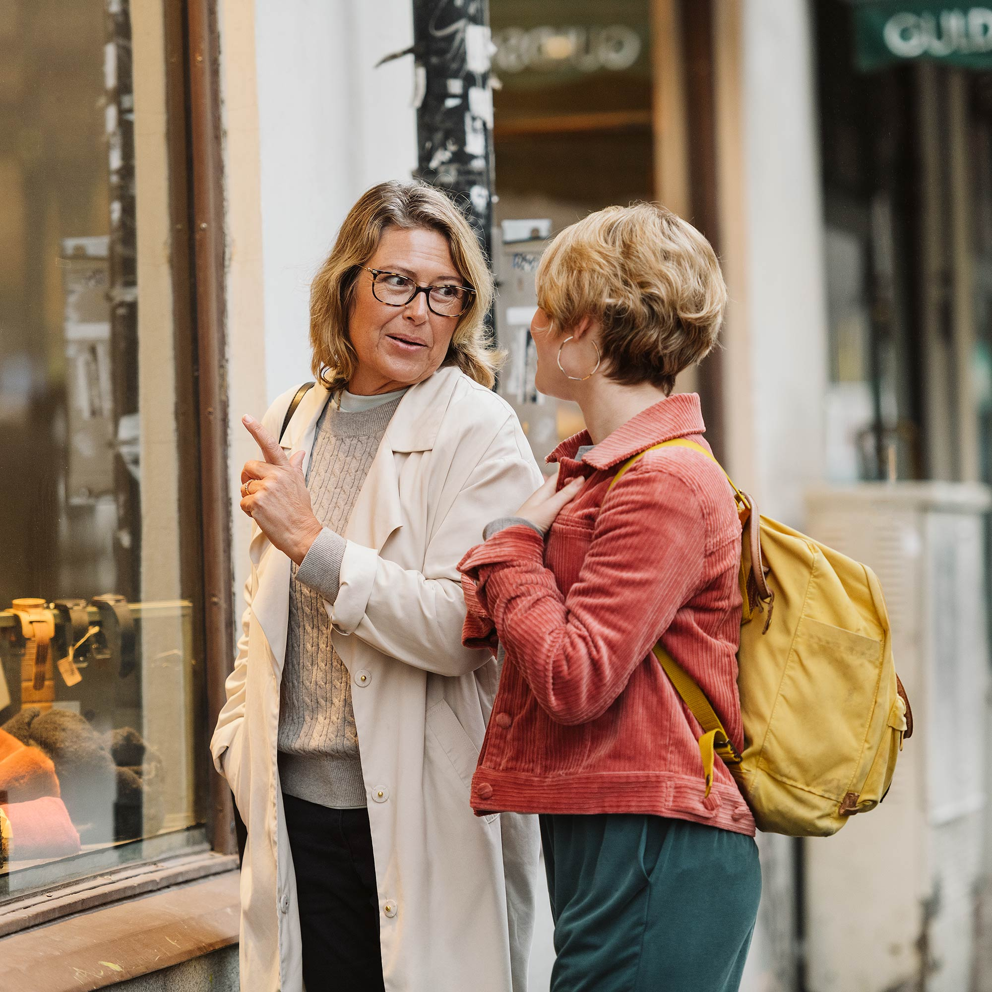 Two women window shopping.